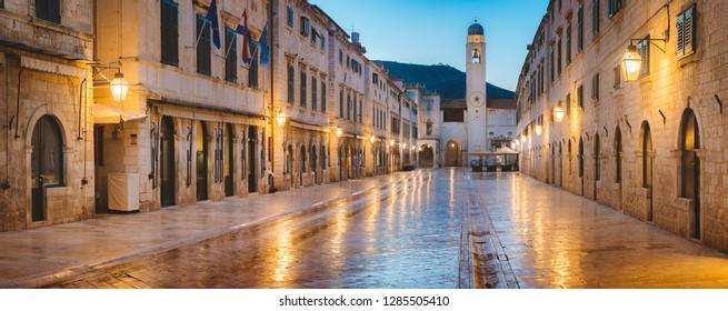 Classic panoramic view of famous Stradun, the main street of the old town of Dubrovnik, in beautiful morning twilight before sunrise at dawn in summer, Dalmatia, Croatia
