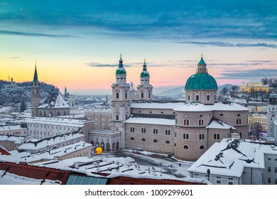 Classic panoramic view of the historic city of Salzburg with famous Salzburg Cathedral in beautiful evening light at sunset in winter, Salzburger Land, Austria