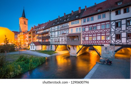 Classic panoramic view of the historic city center of Erfurt with famous Krämerbrücke bridge illuminated at beautiful twilight during blue hour, Thüringen, Germany