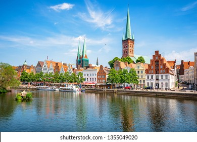 Classic panoramic view of historic skyline of hanseatic town of Lübeck with famous St. Mary's Church on a beautiful sunny day with blue sky in summer, Schleswig-Holstein, Germany