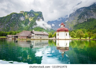 Classic panoramic view of Lake Konigssee with world famous Sankt Bartholomae pilgrimage church and Watzmann mountain on a beautiful sunny day in summer, Berchtesgadener Land, Bavaria, Germany