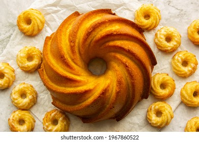 classic Pastries, lemon bundt cakes, small lemon cakes on white background, rustic, grandma's cake, country house kitchen, sweets, delicious, homemade cake,  yellow, dessert, sweet, sugar, retro