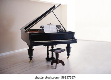 Classic piano in empty room