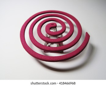 classic pink mosquito coil spiral on white background