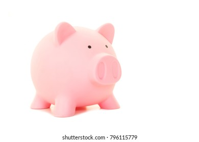 Classic pink piggy bank isolated on a white background