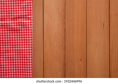 Classic pink plaid fabric or tablecloth on wood desk with copy space