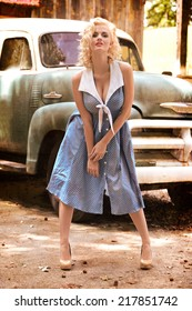 Classic Pinup Beauty in Blue Dress and vintage Truck