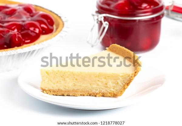A Classic Plain No Bake Cheesecake in a Graham Cracker Crust and Cherries