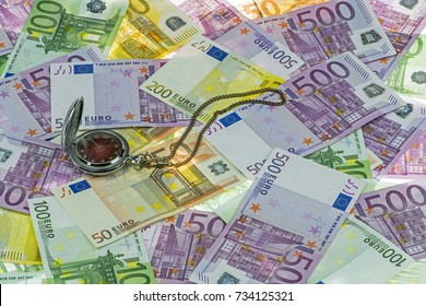 Classic pocket watch on Euro currency (EUR) with 500, 200, 100 and 50 euro bank notes. A concept / idea of time value of money (TVM). Time is money. Many money. Euro background
