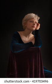 Classic Portrait of Young blond woman on black background - studio shot - romantic moment -  text space