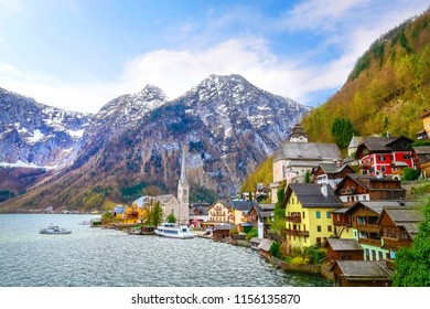 Classic postcard view of famous Hallstatt lakeside village with blue sky and clouds, Hallstatt, Austria, Europe