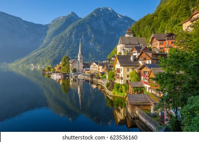 Classic postcard view of famous Hallstatt lakeside town in the Alps in scenic golden morning light at sunrise on a beautiful sunny day in summer, Salzkammergut region, Austria