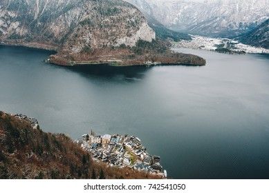 Classic postcard view of famous Hallstatt lakeside town in the Alpson a beautiful cold  day with blue sky and clouds in winter, Salzkammergut region, Austria