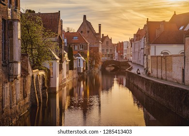 Classic postcard view of the historic city center of Brugge, often referred to as The Venice of the North, in beautiful golden morning light at sunrise, province of West Flanders, Belgium