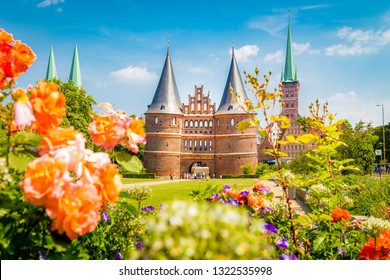 Classic postcard view of the historic town of Lubeck with famous Holstentor gate in summer, Schleswig-Holstein, northern Germany