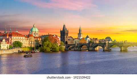 Classic Prague panorama with Old Town Bridge Tower and Charles bridge over Vltava river at sunset, Czech Republic