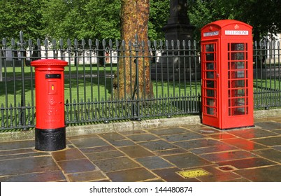 Classic red British telephone booth and post box in London