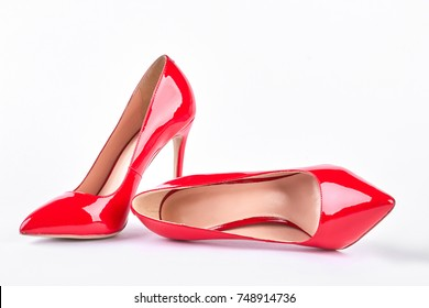 Classic red shoes on high heels. Woman red elegant shoes on heels over white background. Female beautiful accessory.