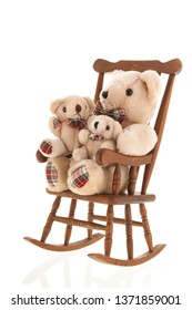Classic rocking chair full with many stuffed bears isolated over white background