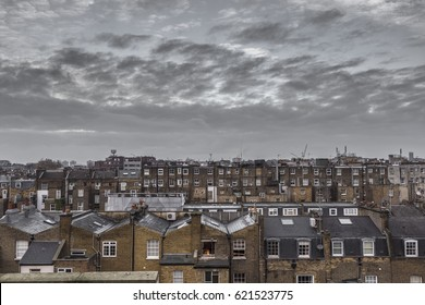 Classic rooftops in London with grey sky and clouds