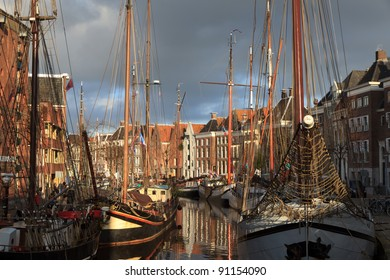 Classic sailing ships at a sailing event in an old harbor in Holland.
