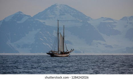 classic sailing two mast ship in  the  fjords of East Greenland in summer