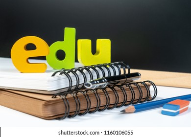 Classic school background with wooden word EDU for education. Education school background concept with equipment pen, pencil, book, backboard and copy space.