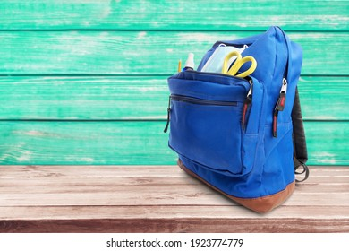 Classic school backpack with colorful school supplies and books