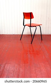 classic school chair on strong red colored floor