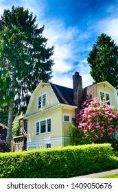 Classic Seattle house with flowering rhododendrons in Ravenna neighborhood of Seattle, Washington