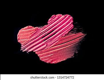 Classic shining glitter pink lipstick smeard black isolated background