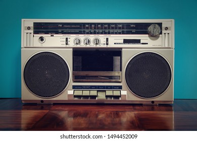 Classic silver boombox against a blue background.