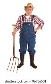 Classic smiling senior farmer with straw hat, plaid shirt, bib overalls, holding hay fork. Vertical layout, isolated on white background with copy space.