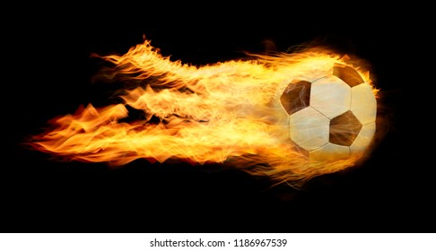 Classic soccer ball on fire on black background