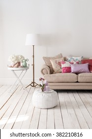 classic sofa and decorative lamps behind white wall interior decor