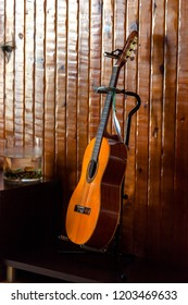 Classic spanish guitar  near of a wood wall