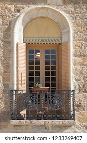 classic Spanish restored building facade with window and flower planter box