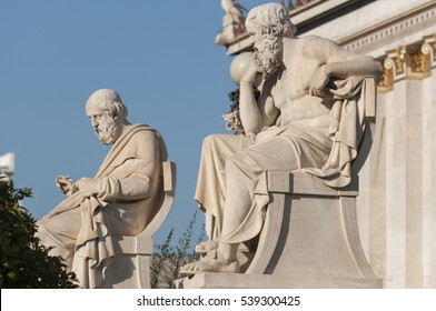 classic statues of Plato and Socrates