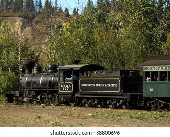 Classic steam locomotive makes its way through the North Saskatchewan River Valley at Fort Edmonton Park.  The EY&P Railroad went out of business over 100 years ago.