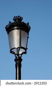 A classic street light against a blue sky