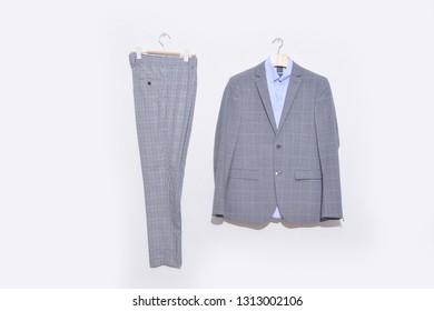 Classic stripy suit, blue shirt, stripy pants on hanging