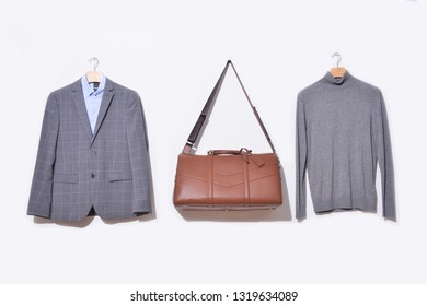Classic stripy suit, blue shirt and brown handbag, gray sweater-whitye  background