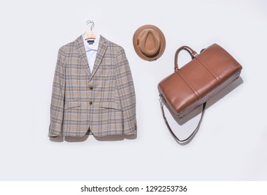 Classic stripy suit, brown sweater and hat ,handbag on hanging