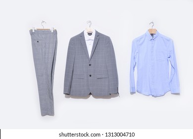 Classic stripy suit, white and blue shirt, stripy pants on hanging