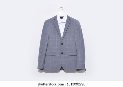 Classic stripy suit, white shirt close up