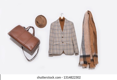 Classic stripy suit, white shirt on hanging with scarf,hat, handbag  on white background