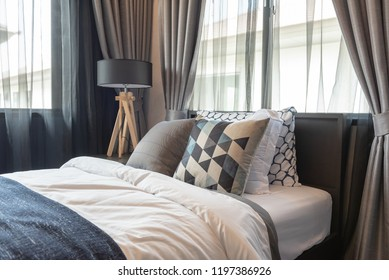classic style bedroom with set of pillows on classic bed, interior decoration design concept