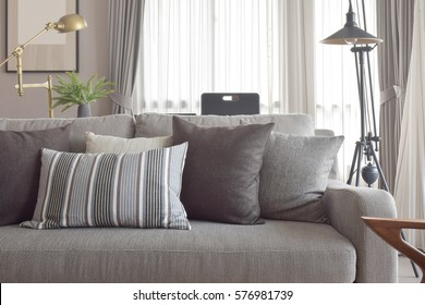 Classic style of pillows and sofa in grey tone color