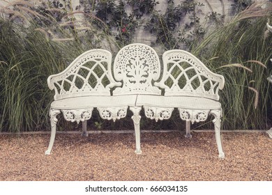 classic style white steel chair with green tree background in garden and retro style