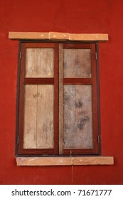 Classic style window on the red wall